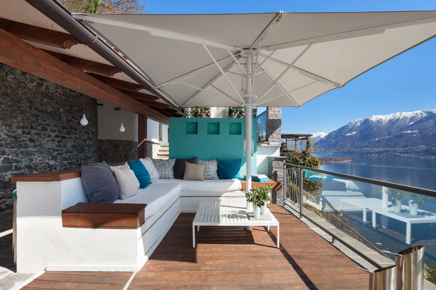 56030134 - Terrace Lounge With Comfortable Divans And Lake View In A Luxury House